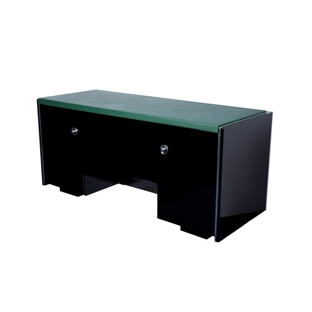 This magnificent Art Deco desk features a classic square design with a top leather-plate in moss. It is fully functional...