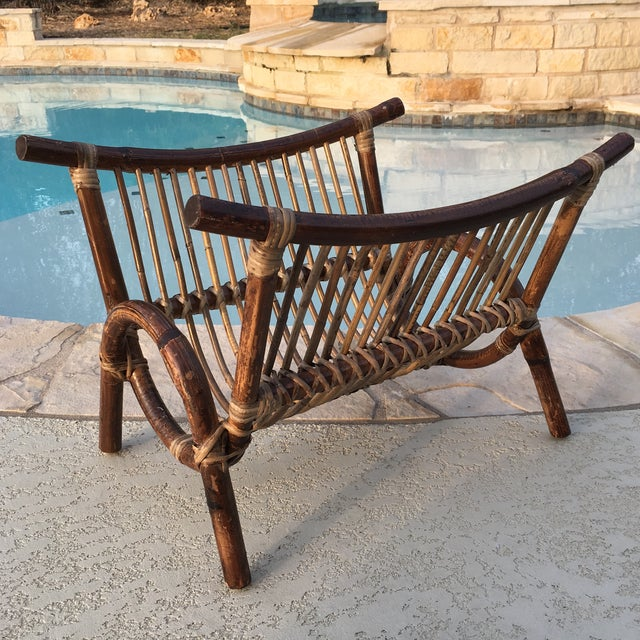 This piece is much older than most rattan pieces I've seen with a unique bentwood ark shape to it. Excellent vintage...
