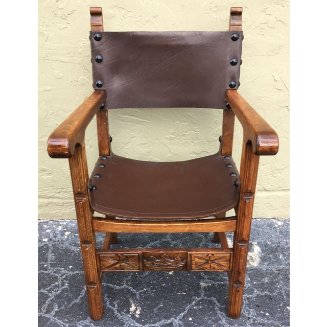 Renaissance style armchair from the Catalan region of Spain. Constructed from richly stained oak and leather, accented...