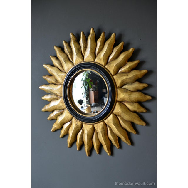 Vintage giltwood convex sunburst mirror, circa 1970. Beautiful gold gilt to the wood and a vintage convex mirror, trimmed...