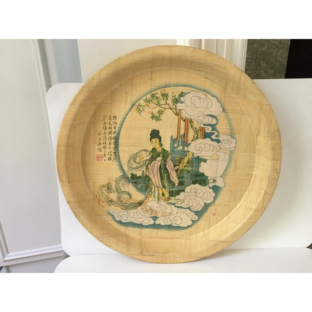 1960's hand painted circular Bamboo Drink Tray with a Chinese female figure, trees, clouds and railing. There are also...