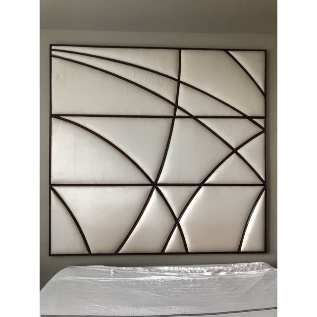 This Christopher Guy headboard is three panels high upholstered with Silk Canvas in the color Magnolia and has a 18th...