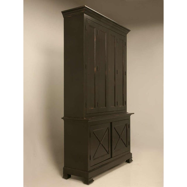 This handsome handmade custom cabinet with bi-fold doors is a replica of an original Directoire period (1793-1804) style....