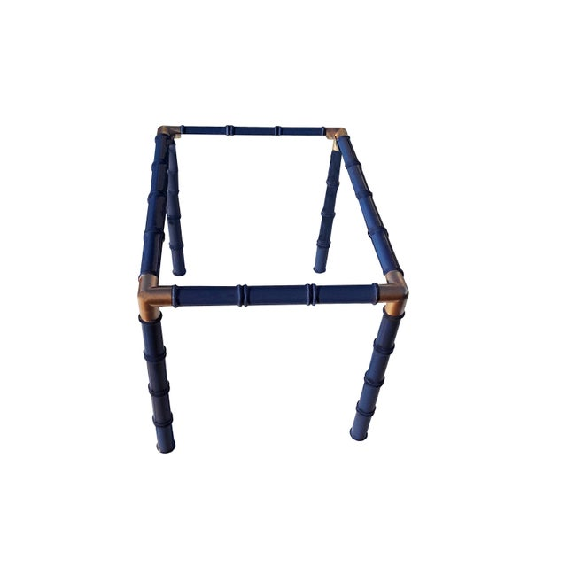 Mid Century pair of faux bamboo glass top tables. Tables have been lacquered in a rich navy blue, with gilt brass corners,...