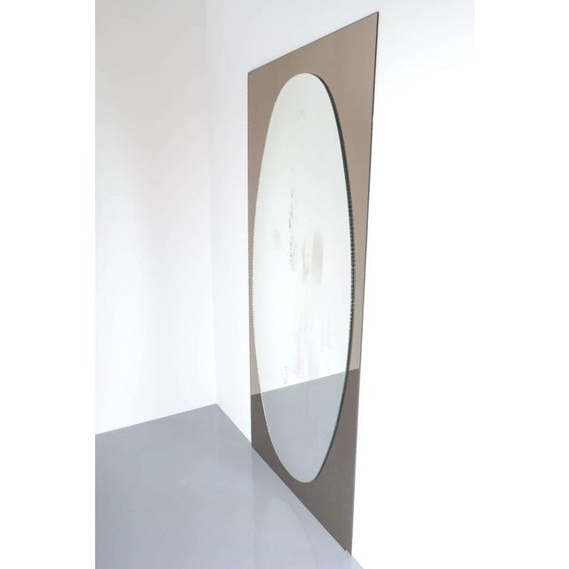 """Beautiful and full length 73"""" mirror with a bronzed églomisé´ and artistically chipped mirrored frame and an oval chipped..."""