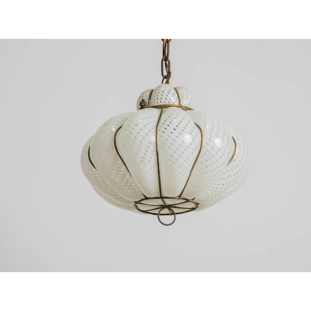 Handblown into a wire cage, this Italian fixture is from the 1950s.