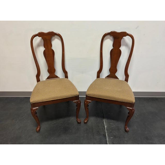 Pair of dining side chairs in solid cherry wood by Fancher Furiture Co of Salamanca, New York, USA. Made in the United...