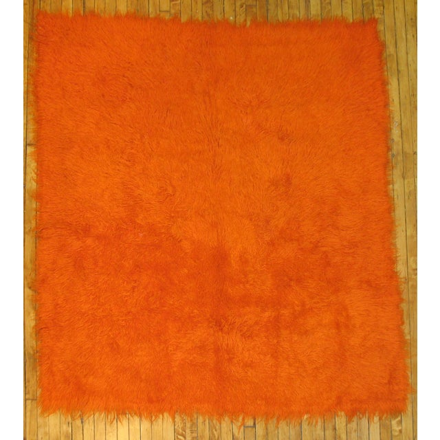 This handmade one-of-a-kind Turkish Rug will add the most amazing pop of color to your room. Featuring a fire orange...