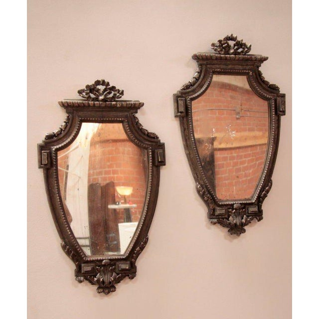 Elegantly carved, this bellisima pair of mirrors will do the job! 'May be sold separately'.