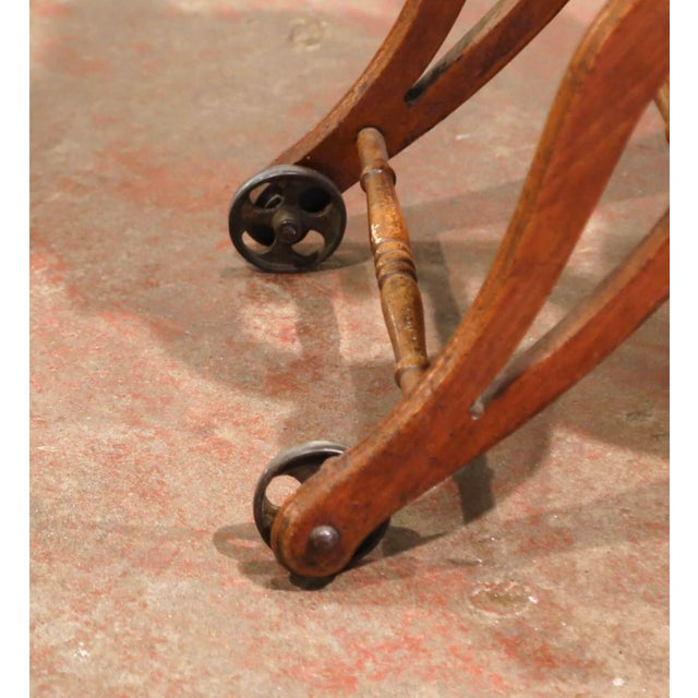 19th Century English Carved Walnut and Leather Adjustable High Chair Rocker For Sale - Image 12 of 13