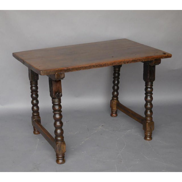 Beautiful all original walnut table with turned legs and one wide board on top. It has old repairs which do not the...