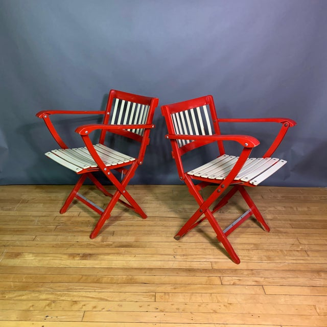 A wonderful bright pair of folding chairs by a leading Italian mid-century manufacturing firm Fratelli Reguitti from the...