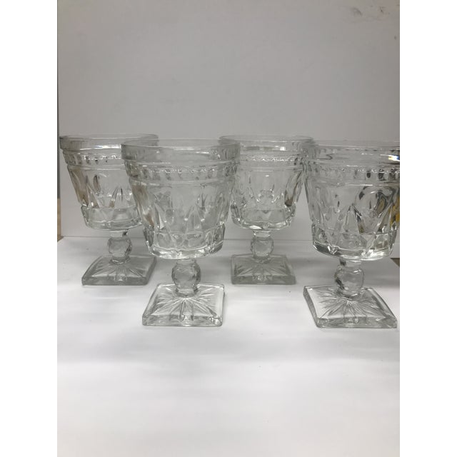 Classic mid-century goblet-style glasses for water or wine by the Indiana Glass Company. Lovely design and durable pressed...