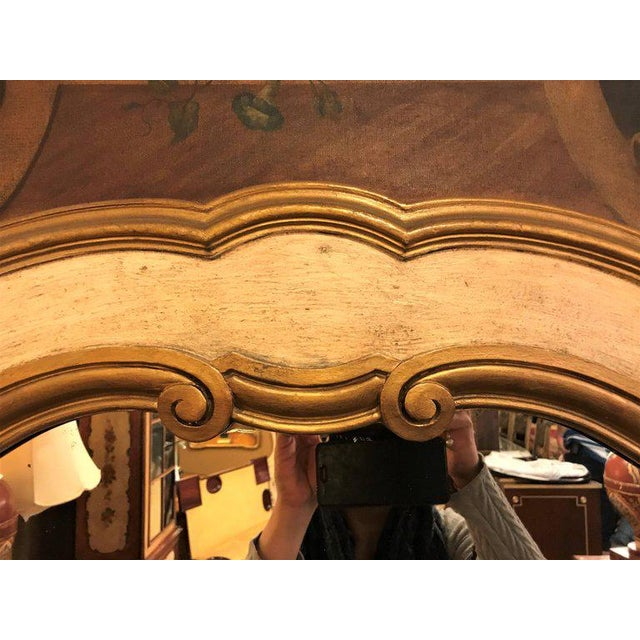 French Antique Painted And Parcel Gilt Trumeau Mirror With Oil Painting Center. A large and impressive mirror with a...