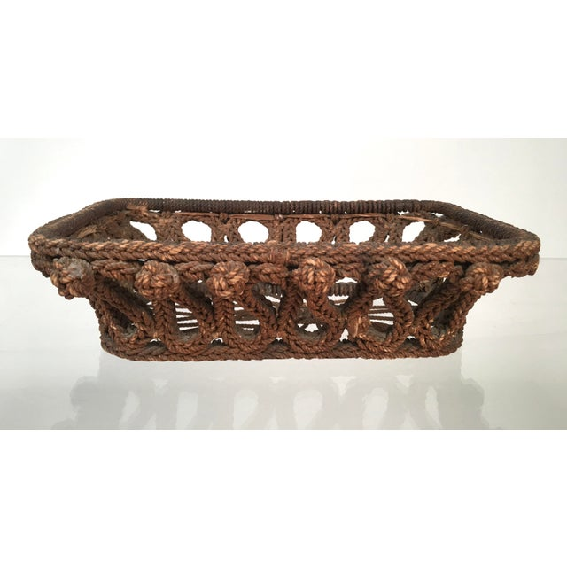 A wonderful 19th century sailor-made rope work basket with intricately knotted sides and openwork bottom. From sea chest...