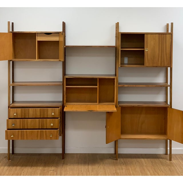 Mid Century Vintage Wall Unit made in Yugoslavia. Estimated to be made around the 1950s. Wood is unknown, however remains...