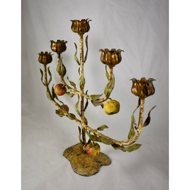 A marvelous French Tôle Peinte Tree of Life candelabra, made of hand-painted iron, circa early 1900s. Showing a lovely...
