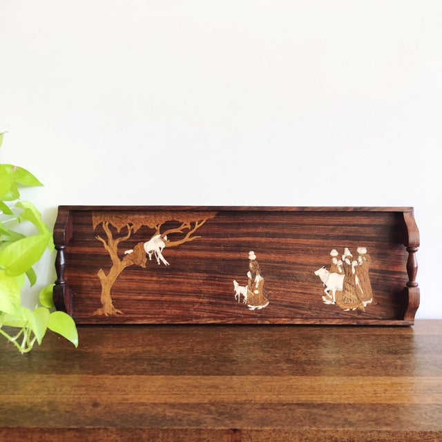 Antique rosewood tray with inlaid bone; made in British India circa 1920s. The top features a marquetry village scene with...