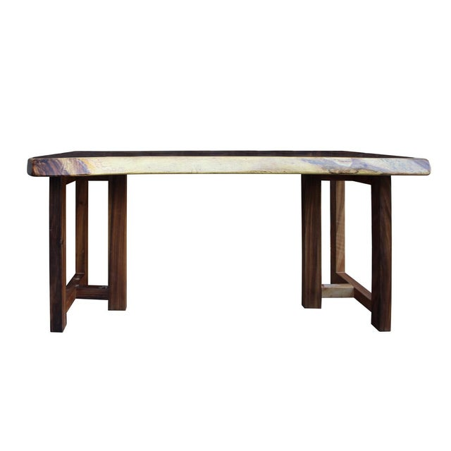 This is a polished rectangular shape raw wood plank table / desk with brown color wood base. The surface shows the wood...