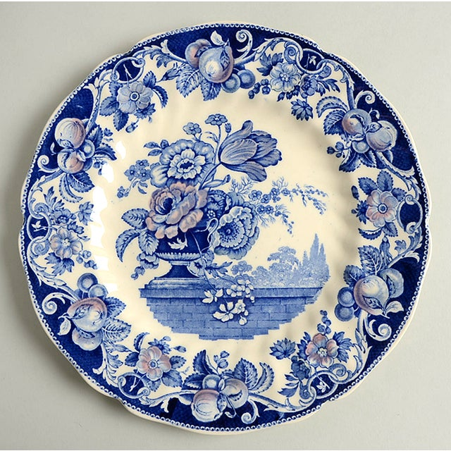 Royal Doulton Pomeroy-Blue Dinner Plate S/8 features a primary blue theme design with muted multicolor accents, a central...