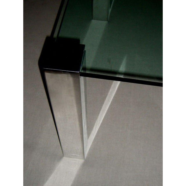 A nicely designed by Paul M Jones adjustable aluminum legged glass table. The legs feature an adjustable screw that...