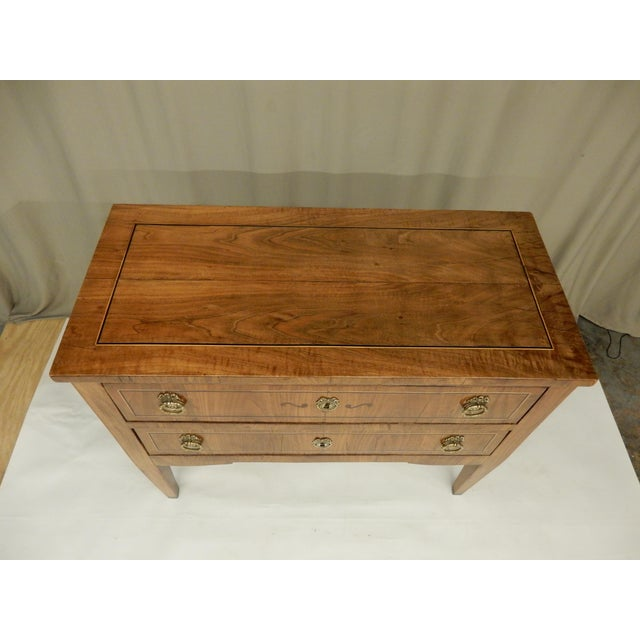 Carefully restored Italian walnut commode with inlaid and two drawers.