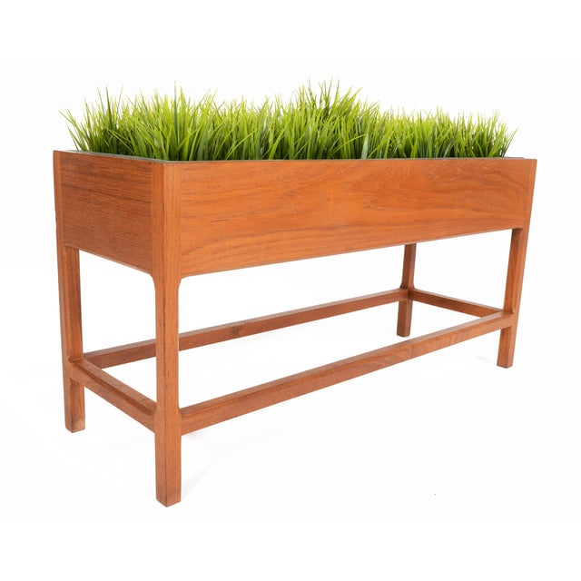 This gorgeous Danish modern planter box by Aksel Kjersgaard features a solid teak construction and a beautifully designed...