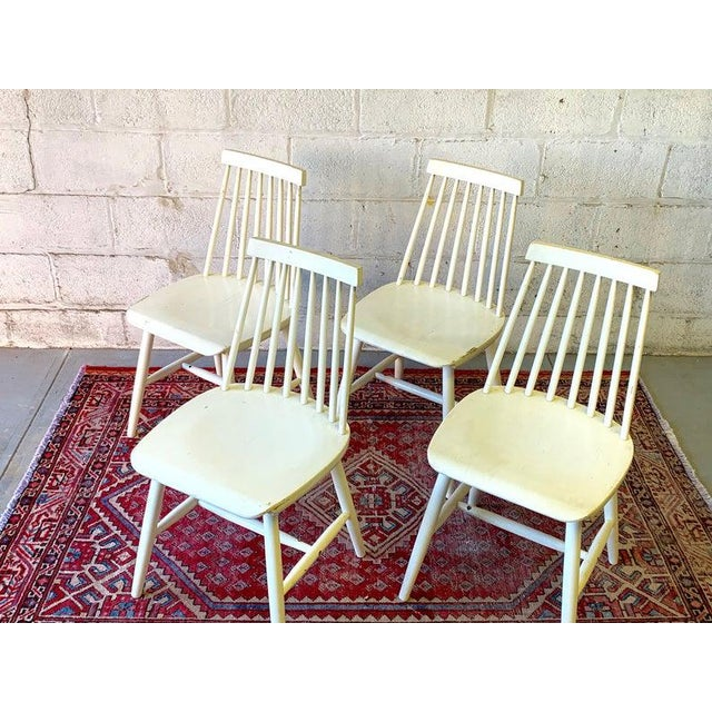 Mid Century Modern spindle back dining chairs / side chairs. Solid + sturdy with lovely lines and design. Good vintage...