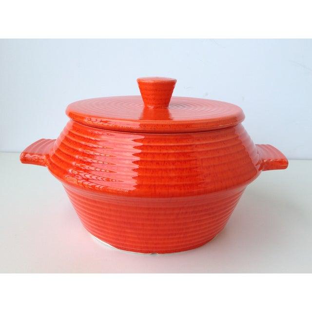 Vintage 1960s glazed ceramic U.S.A. California pottery lidded soup tureen or lobster pot in a day-glo orange glazed finish...