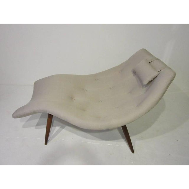 A sculptural Adrian Pearsall chaise longue chair designed at the top of his game with sensual curves forming a womb like...
