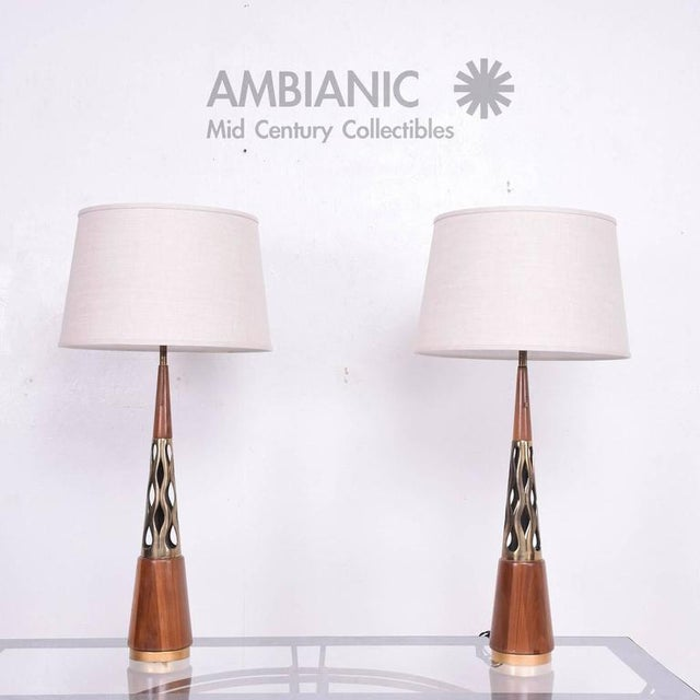 For your consideration a pair of Mid-Century modern table lamps with cone shape. Walnut with Brutalist sculptural brass...
