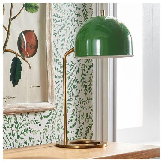 A rich, vibrant green metal shade mixed with a clean, modern base makes for a stand-out design. A handsome, bold pop of...