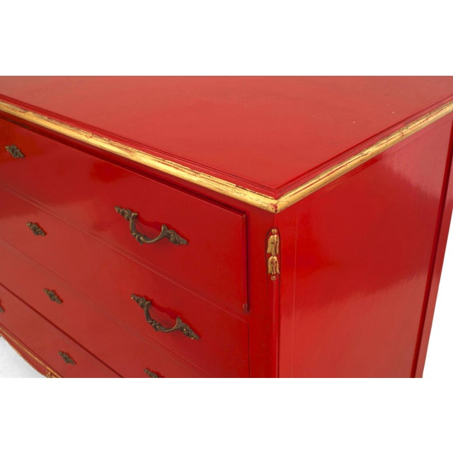 French 1940s (Louis XV style) red lacquered chest having three drawers with gilt and bronze trim (stamped: JANSEN). Maison...