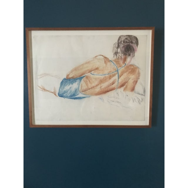 This wonderful vintage drawing is of a reclining woman in a blue bathing suit. She is tanned and appears to be reclining...