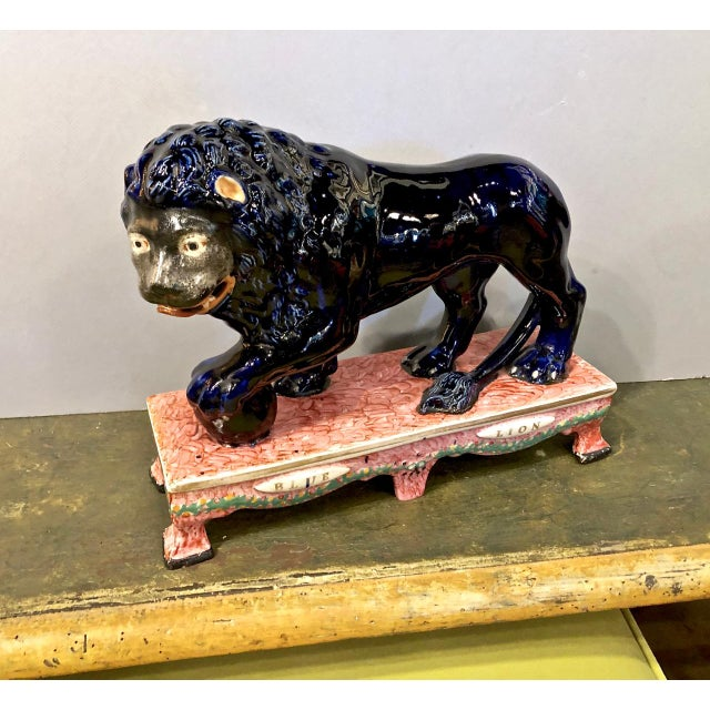 This is an uncommon Staffordshire Blue Lion that dates to the early 20th century. the lion is mounted on a Sherratt-style...