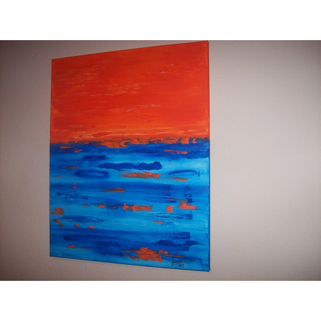 """Driving 'Till Sunset"" features bright orange in beautiful contrast with the deep blues that create this vibrant piece...."