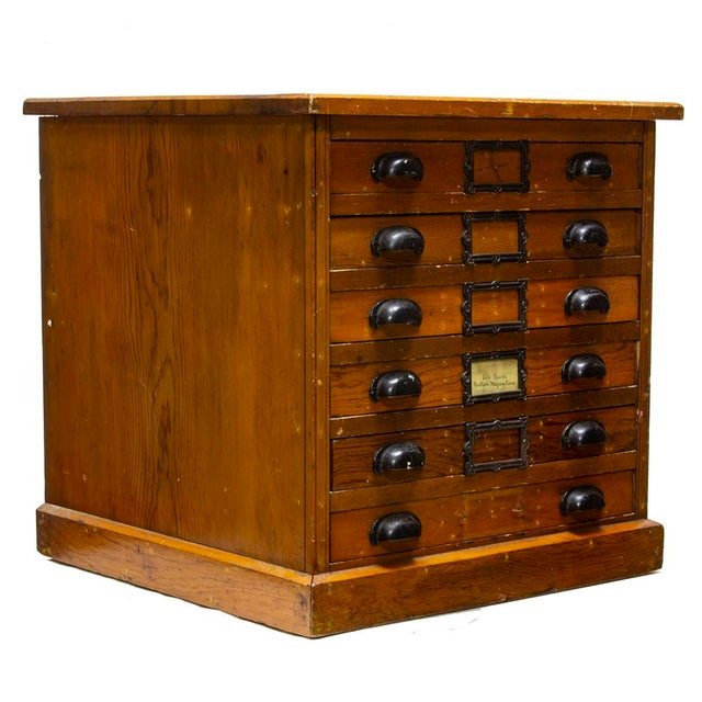 This little cube is a delightful drawer set. Double bin pulls adorn each drawer, as does an ornate cast label holder with...