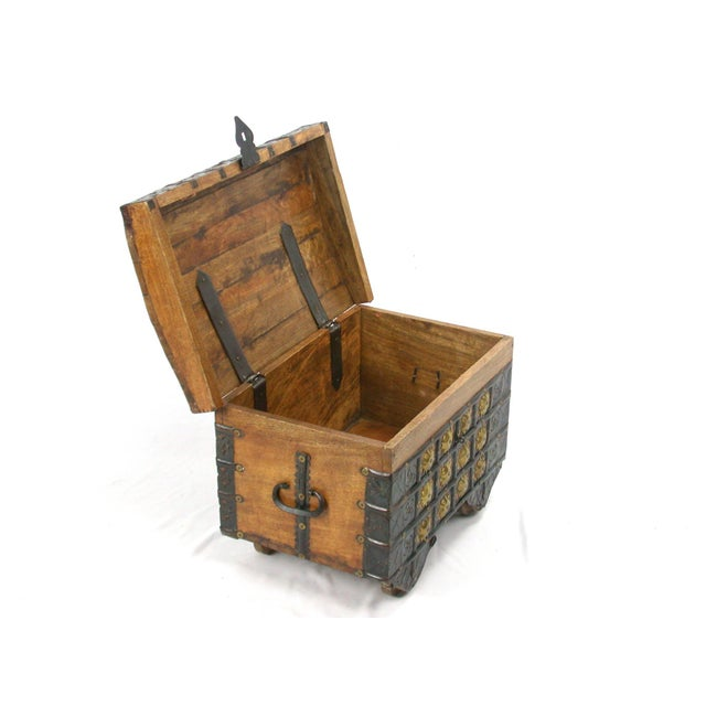 This is a small chest made of acacia wood and hammered metal brass details. Finally the perfect place for all your...