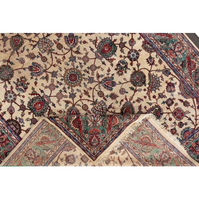 Vintage hand-knotted Persian rug with a floral motif. This one of a kind piece has great colors and a beautiful design. It...