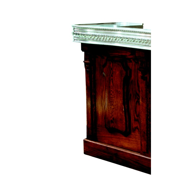 pewter and oak French Pewter top cast with a base made of french oak. Includes 1 drawer and 4 shelves, intricate drain...