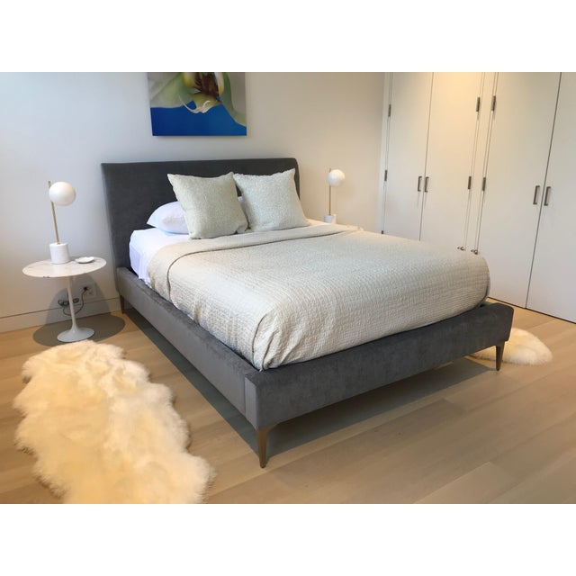 Designed with clean lines and upholstered in soft gray worn velvet, the Andes Deco Upholstered Bed brings refined luxury...
