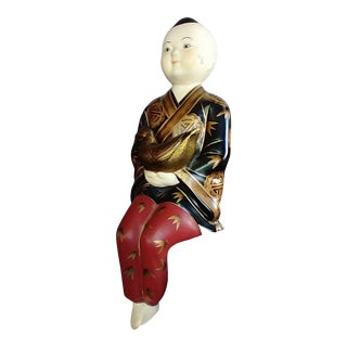 Late 20th Century Sitting Red & Black Porcelain Figurine of Sitting Asian Man For Sale