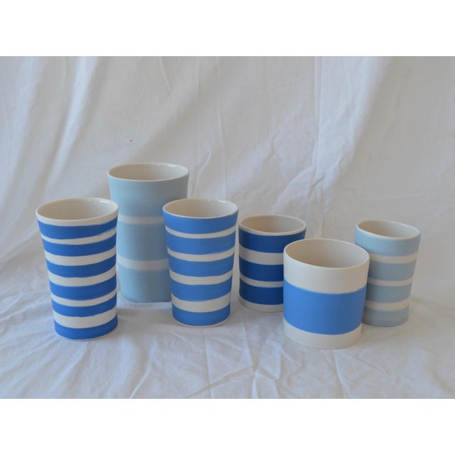 This is a set of 6 cylindrical vessels is glazed on the exteriors with yummy matte satin stripes in various shades of blue...