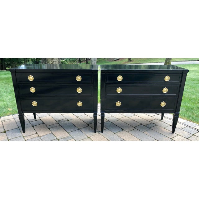 Pair Neoclassical style black lacquered three drawer small chest/night stands. Pristine brass hardware.
