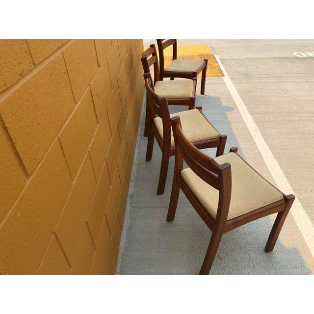 4 Dyrlund Danish Teak vintage Mid Century Chairs in amazing shape.