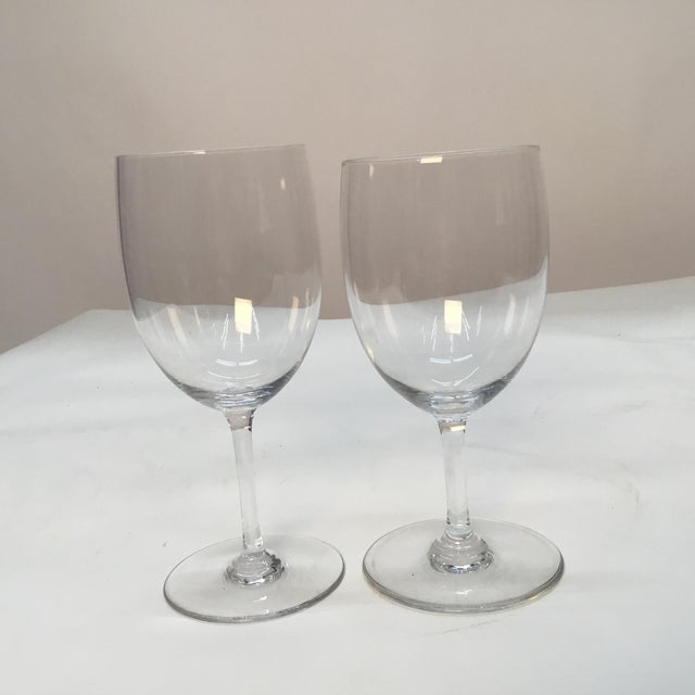 "Pair on Baccarat crystal wine glasses. Not identical - one is 6.5"" and the other 6.25"" tall. excellent condition. Etched ""..."