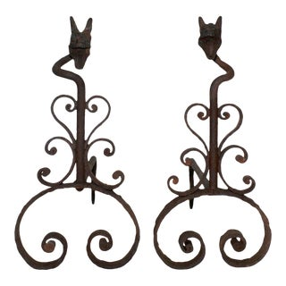 Late 19th Century Folk Art Wrought Iron Andirons With Scroll Motifs and Grotesque Head Finials - a Pair For Sale