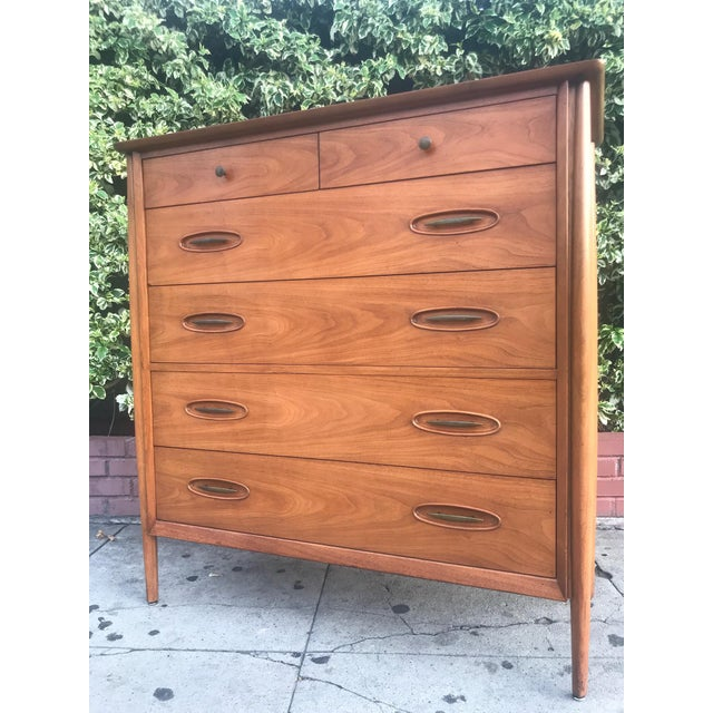 Stunning mid-century modern tall boy dresser by Morganton Furniture. Made in solid walnut this piece is quality! Four...