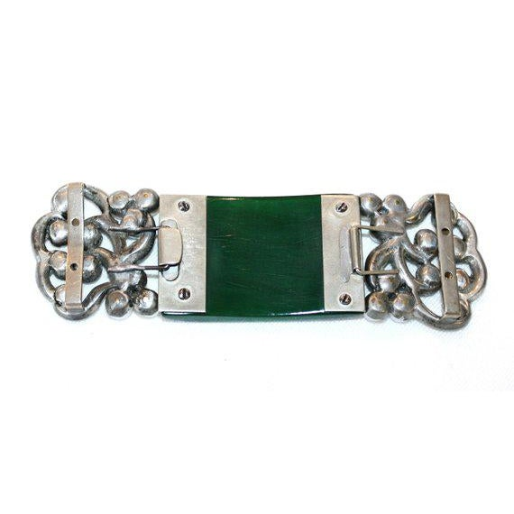 Beautiful and rare c.1930's silvertone metal belt buckles with a large carved Bakelite centerpiece embellished on each...