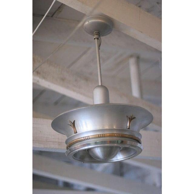 Aluminum ceiling pendants with elegant neoclassical brass accents. Pair.